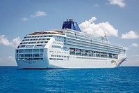 """The NCL cruise ship """"""""Norwegian Sky"""""""" anchored in the calm tropical waters of the Bahamas."""