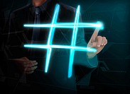 Illustration of businessman making glowing hashtag on transparent screen.