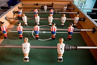 A table for table football in the pub, visible figures of toy mini football players.