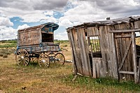 An old west sheriff´s wagon sits on the lonesome frontier prarie as storm clouds gather in the distance.
