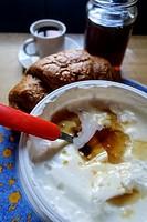 Greek Cusine. Yogurt with Thyme Honey, Coffee and Croissant.