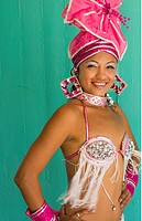 Trinidad Cuba beautiful dancer in costume portrait with headress and color from tourist show 12.