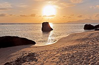 Sunset on the beach at Source d'Argent, La Digue, Seychelles.