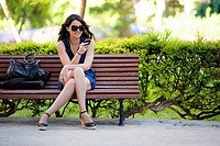 young woman sitting on bench.