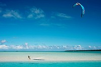 Aitutaki. Cook Island. Polynesia. South Pacific Ocean. Some kite surfing on the beach in Aitutaki Lagoon Resort & Spa Hotel. Go Kayaking - Kayaking is...