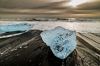 Small icebergs standed on black shore of Jokulsarlon beach. Vatnajokull National Park, Iceland.