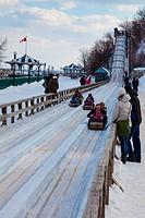 Families enjoying a toboggan slope in old Quebec City.