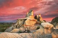 Clearing storm at sunrise over badlands sandstone formations, Theodore Rossevelt National Park, North Dakota.