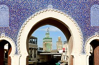 The Bab Bou Jeloud is a recent addition to Fes El Bali, having been built around 1913. The Medersa Bou Inania minaret is framed by this impressive gat...