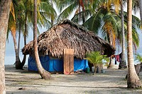 traditional hut of the Kuna Indians on the sandy beach of San Blas Islands, Panama, Central America.