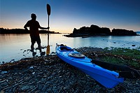 Sea kayaker at sunset, Pipers Lagoon Park, Nanaimo, Vancouver Island, British Columbia