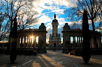 Sunset behind the monument to Alfonso XII of Spain in Retiro Park at Madrid, built in memory of the king that not only restored Borbón Spanish dinasty...