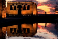 A human silhouette framed by a spectacular sunset over Temple of Debod in Madrid, an Egyptian shrine donated by Egypt in 1968 in gratitude for Spanish...