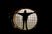 Human silouette fitted in a big circular window with iron bars, Monastery of Santa Maria de Carracedo, Carracedelo, province of León, Castilla y León,...