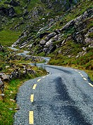 Narrow road winding through the Ballaghbeama Gap, County Kerry, Ireland.