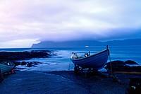 Fishing boat in harbour of village of Gjójv, Eysturoy, Faroe Island.