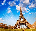 Wonderful view of Eiffel Tower in Paris. La Tour Eiffel with sky and meadows.