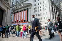 Visitors outside the New York Stock Exchange decorated for the first day of trading for the Alibaba IPO on Friday, September 19, 2014. The mammoth e-c...