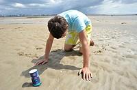 Fishing razor shells with salt. Normandy, France