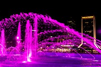 Friendship Fountain, Jacksonville, Florida, USA at night. Across the river can be seen downtown Jacksonville and the Jacksonville Landing. The fountai...