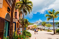 A cruise ship in port at Charlotte Amalie, St. Thomas, US Virgin Islands seen from the dockside shopping center.