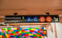 Brooklyn and Downtown street sign in New York Subway.