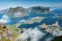 Aerial view over the village of Reine and fjords and mountains in the Lofoten Islands, Norway.