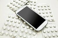 Medical smartphone. A modern cellphone with pills.