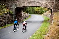 Cyclists and Stone Bridge - Acadia National Park - Bar Harbor, Maine USA.