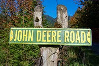 John Deere Road sign on a post.