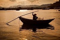 Old Woman in Traditional Fishing Boat, Sau Mun Tsai Fishing Village.