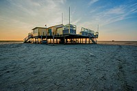 Schiermonnikoog, Netherlands. Beach house on wooden poles on the UNESCO Wadden Island Schiermonnikoog´s most northern beach, bordering the North Sea.