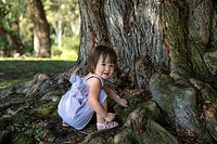 Toddler girl playing under a tree, San Diego, California.