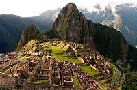 View of the Machu Picchu landscape. Machu Picchu is a city located high in the Andes Mountains in modern Peru. It lies 43 miles northwest of Cuzco at ...