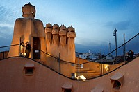 Casa Mila, La Pedrera, skyline of Barcelona, Spain. The chimneys. Panorama of the roof at dusk, evening, night. Unesco Heritage. Even if architecture ...