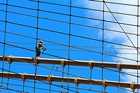 Worker walking on Brooklyn bridge, New York City, USA.