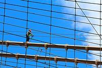 Worker walking on Brooklyn bridge, New York City, USA.