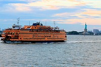 Staten Island Ferry with the statue of liberty in the background, New York City, USA.