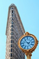 Flatiron building and giant clock, New York City, USA.