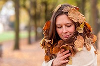 Natural style, woman wrapped in leaves in hair.