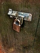 Padlock on wooden gate.