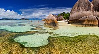 Panoramic landscape view of tourists enjoying a sunny day on the famous Anse source d´Argent beach. La Digue Island, Seychelles.