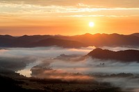 Landscape photo of a colourful sunrise over a misty Vaal River valley. Vredefort Dome, Freestate, South Africa.