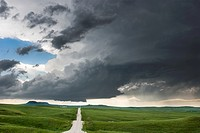 Supercell storm with small tornado moves across the badlands area of southwest South Dakota near Kadoka, June 7, 2005.
