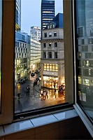 Looking at Kaiserplatz, Frankfurt, Germany, on a Rainy Night. through an open window.