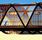 Cyclist passing by the Arganzuela bridge, designed by architect Dominique Perrault. Madrid Rio Park. Madrid. Spain.