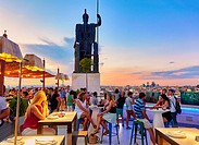 """People at the """"""""Tartan Roof"""""""" restaurant, located at The Circulo de Bellas artes cultural center rooftop terrace. Madrid. Spain."""