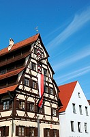 The Siebendächerhaus in Memmingen with city flag hoisted, Bavaria, Germany