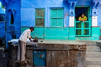 A Man Irons Clothes Outside His House, Jodhpur, Rajasthan, India.