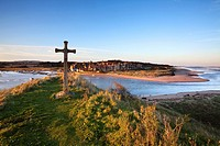 St Cuthberts Cross on Church Hill and Alnmouth at Sunset Northumberland England.